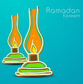 Holy month of Muslim community Ramadan Kareem background with illuminated tradition lanterns on blue