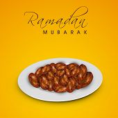 Muslim community festival Ramadan Mubarak background with fresh dates for Iftar food.