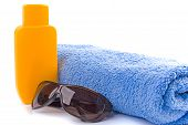 Towel, Sunglasses And Lotion poster