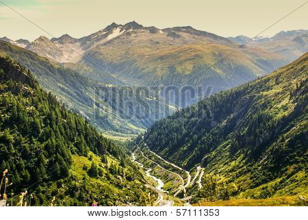 View Through Alps Valley Near Gletch With Furka Pass Mountain Road, Switzerland