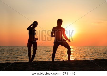 Dancing On The Beach During A Sunset