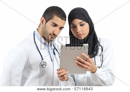 Saudi Arab Doctors Working With A Tablet
