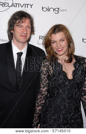 Milla Jovovich, Paul W.S. Anderson  at the 2011 Art Of Elysium