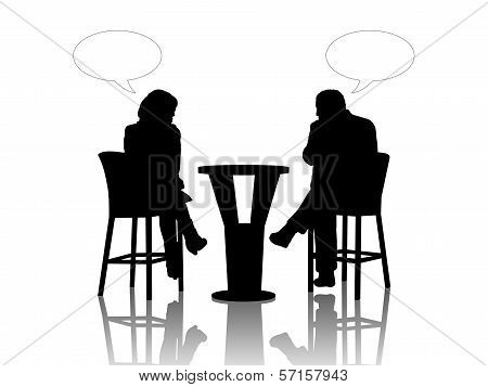 Man And Woman Speaking At The Table In A Cafe