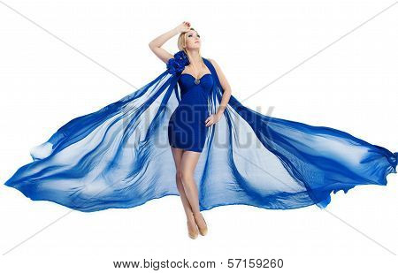 Woman In Blue Fluttering Dress Waving On Wind Over White
