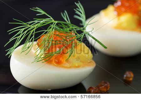 Staffed Eggs With Red Caviar Garnish And Dill Decoration