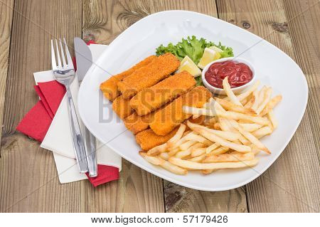 Portion Of Fish Fingers On Wooden Background