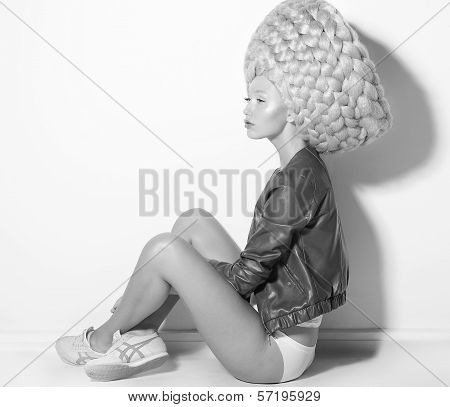 Vogue. Fanciful Eccentric Woman Fashion Model In Creative Periwig Sitting
