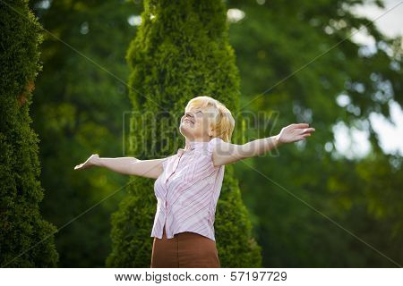 Lifestyle. Freedom. Excited Retired Old Woman With Outstretched Arms