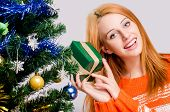 foto of merry chrismas  - Girl near the Christmas tree with gift listening what - JPG
