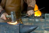 stock photo of blacksmith shop  - A blacksmith at the work  - JPG