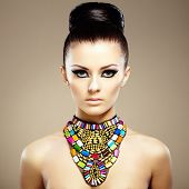 picture of jewelry  - Portrait of young beautiful woman with jewelry - JPG