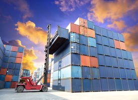 image of forklift  - forklift handling the container box at dockyard with beautiful sky - JPG