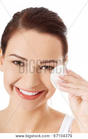 Beautiful woman using cotton pad
