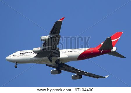 Qantas Airline Boeing 747-400 in New York sky before landing at JFK Airport