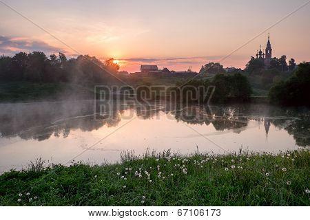 Sunrise In A Small Russian Village.