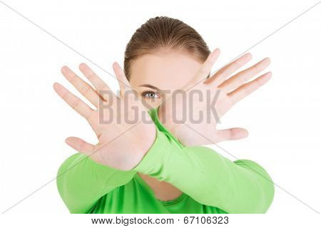 Hold on, Stop gesture showed by young woman hands