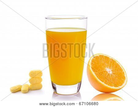 Full Glass Of Orange Juice And Vitamin C Pills