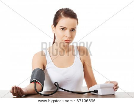 Woman doing blood pressure test