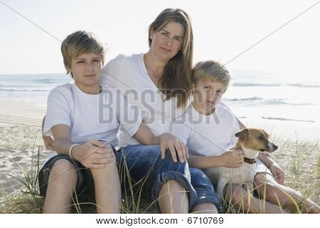 Family Sitting On The Beach