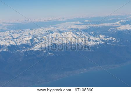 Caucasus mountains and Caspian sea. View from the airplane.