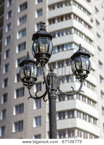 Beautiful lantern on a background of a multi-storey modern residential building