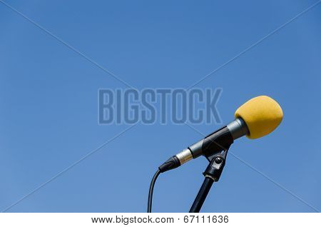 Yellow Microphone Blue Sky Background