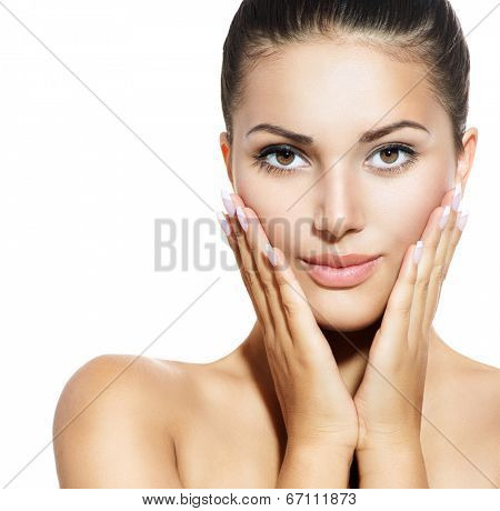Beautiful Face of Young Woman with Clean Fresh Skin isolated on white. Beauty Girl touching her face. Beautiful Spa Woman Smiling. Perfect Fresh Skin. Pure Beauty Model. Youth and Skin Care Concept