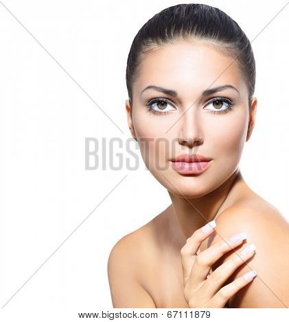 Beautiful Face of Young Woman with Clean Fresh Skin isolated on white. Beauty Girl touching her skin. Beautiful Spa Woman Smiling. Perfect Fresh Skin. Pure Beauty Model. Youth and Skin Care Concept