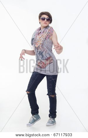 Teen girl in jeans and sunglasses