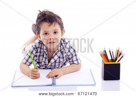 Schoolboy drawing with colored pencils, isolated on white background
