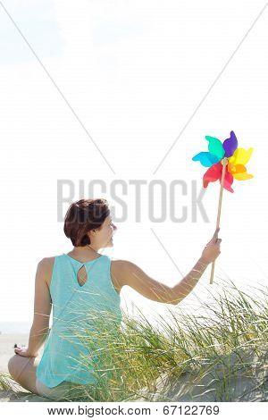 Woman Holding Pinwheel Outdoors