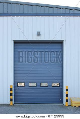 Factory loading bay roller door on industrial building