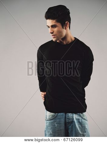Young Man In Casuals Looking Away At Copyspace