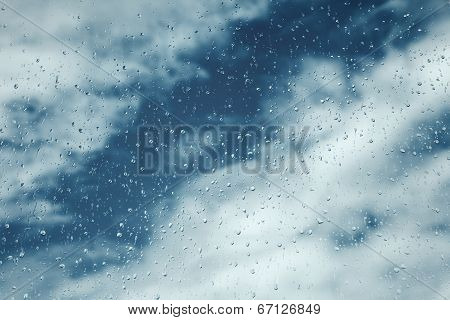 Drops On Window, Blue Sky With Clouds On Background