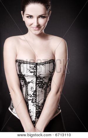 Smiling Woman With Cleavage In A Corset