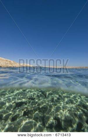 Split View Desert Coastline Blue Water
