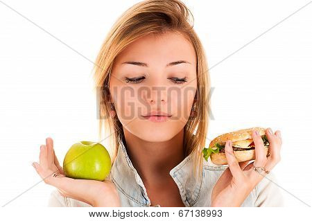 woman choosing between apple and hamburger