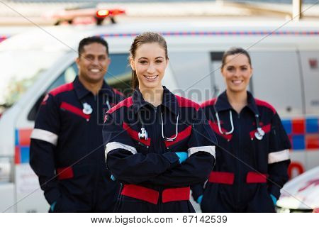 group of emergency medical technicians in front of ambulance