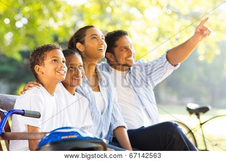 beautiful indian family bird watching outdoors