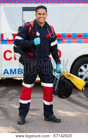 happy indian paramedic carrying portable medical equipments