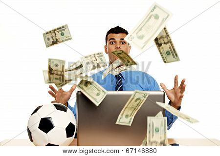 Suprised young businessman with money