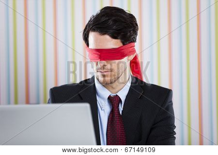 Blind businessman working at the office