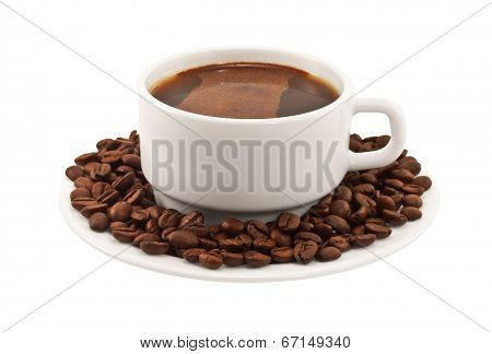 White Cup Of Coffee With Beans On A Plate