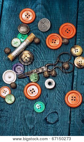 buttons and zipper on the background of sewing tool