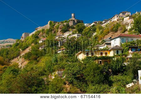 Historical UNESCO protected town of Gjirocaster with a castle on the top of the hill, Southern Albania after dusk