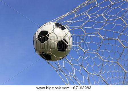 Socce In The Goal Net