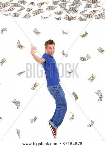 Happy man enjoying rain of money, isolated on white