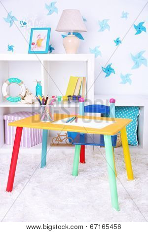 Modern playroom for children with bright table