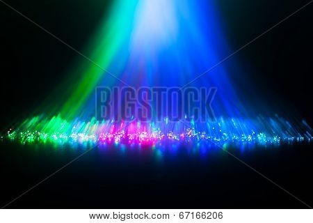 Glowing tips of optical fiber in dark.